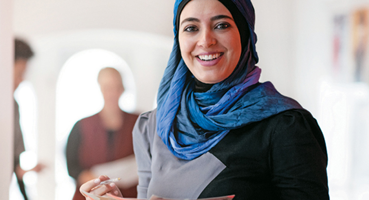 Smiling woman wearing head scarf